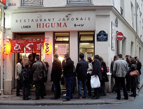 IMG: Lining up for ramen (lamen) in Paris.